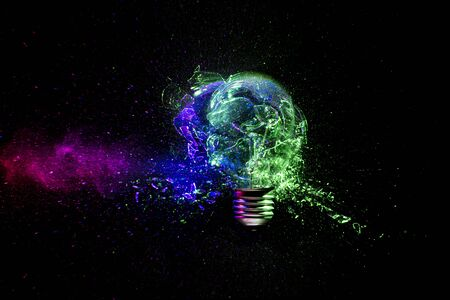 destruction of a tungsten light bulb hit by a bullet. glass fragments around, colored lights. high speed photography.