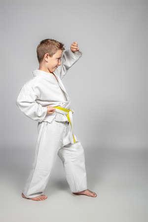 7 year old boy practices jujitsu. Sport and martial arts concept. 版權商用圖片