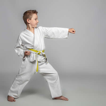 child practicing martial arts intent on performing a kata. youth sport concept. 版權商用圖片