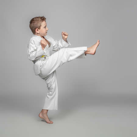 portrait of a child wearing martial arts judogi in the rei position.