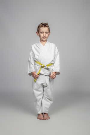 portrait of a child wearing martial arts judogi.