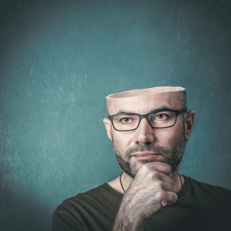 Portrait of man with empty open head. concept of creativity