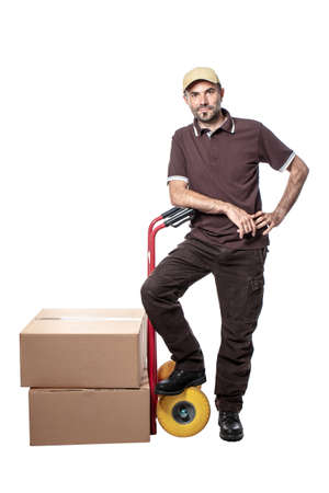 delivery man with handtruck and parcel isolated on white