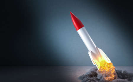 missile starting with flames and smoke. 3d render image. concept of success and beginning. Imagens
