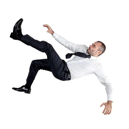 businessman falling down isolated on white. Reklamní fotografie