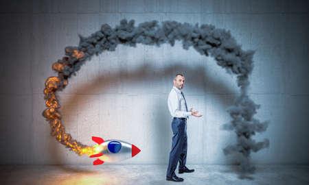 businessman launches a rocket but fails. crisis and problems concept.