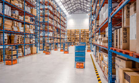 interior of a modern warehouse where automated goods transport vehicles work. 3d render.