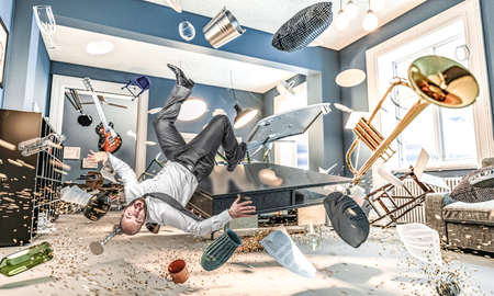 man fall, interior of a house with flying objects and in disorder. concept of confusion, disaster. 版權商用圖片