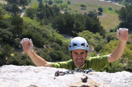 A happy climber who arrives at the summit. Stock Photo - 8779036