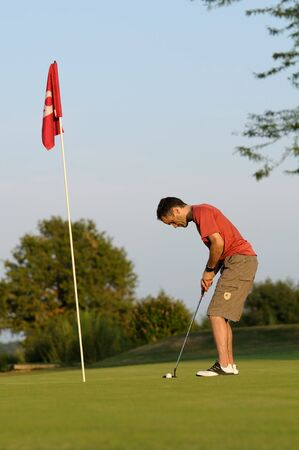 a golfer in concentration photo