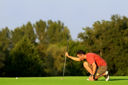 putting green: a golfer in concentration