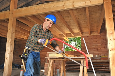 a carpenter working in his house photo