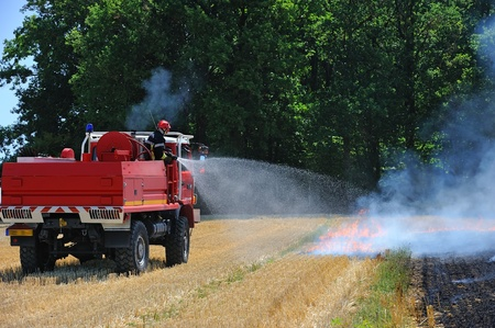 a fire wheat fields in the countryside photo