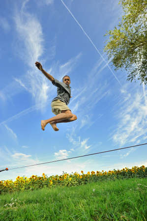 jump to a tightrope walker on a wire photo