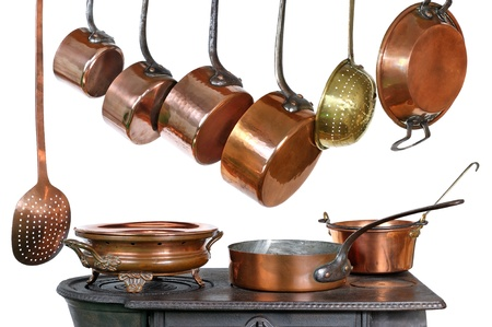 pots and pans: pans and kitchen utensils in copper Stock Photo