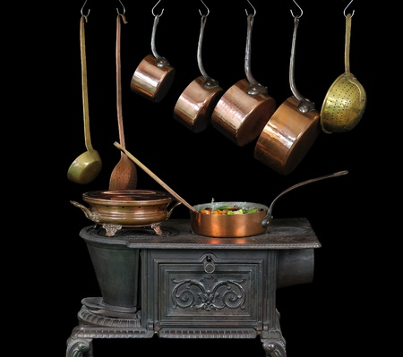 pans and kitchen utensils in copper photo