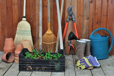 gardening gloves: a garden shed with all the tools of the gardener Stock Photo