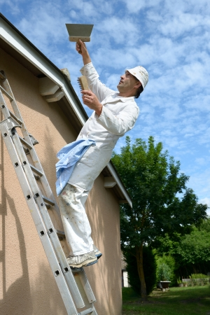 a working house painter who tumbles the ladder photo