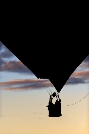 ballooning: silhouette of a balloon flight Stock Photo