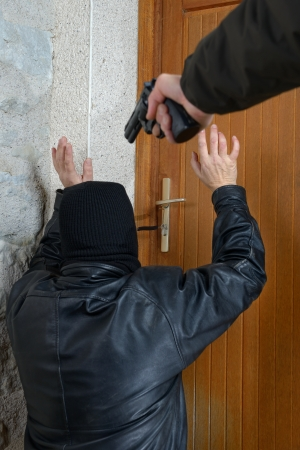 a burglar caught in the act of opening the door Stock Photo - 17117014