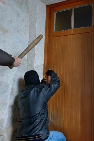 malefactor: a burglar caught in the act of opening the door