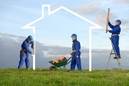 builds: a worker who builds the house Stock Photo