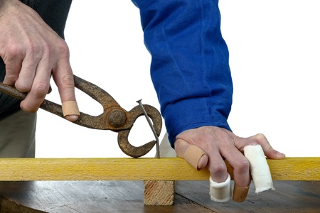 clumsy: a handyman awkward trying to hammer a nail Stock Photo