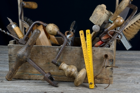 a box of old tools for woodworking photo