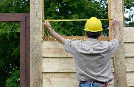 a worker who builds the wood house Stock Photo - 19703544