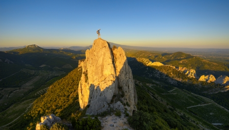 climbing wall: a climber at the summit of a mountain