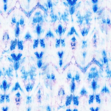 Beautiful seamless tie-dye pattern on white silk. Batik-hand painting fabrics - nodular batik. Shibori dyeing.