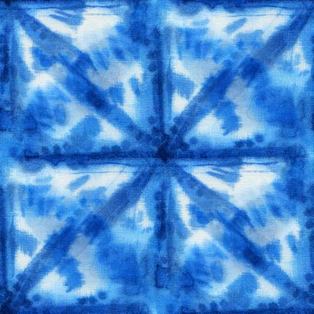 white silk: Seamless tie-dye pattern with circles of indigo color on white silk. Hand painting fabrics - nodular batik. Shibori dyeing. Stock Photo