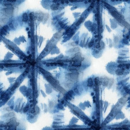 dyeing: Seamless tie-dye pattern with circles of indigo color on white silk. Hand painting fabrics - nodular batik. Shibori dyeing. Stock Photo