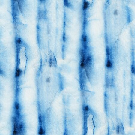 dyeing: Seamless tie-dye pattern of indigo color with vertical stripes. Hand painting fabrics - nodular batik. Shibori dyeing.