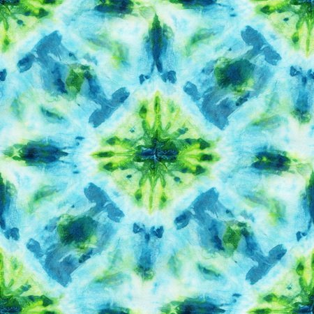 dyeing: Seamless tie-dye pattern with a green and blue geometrical ornament. Hand painting fabrics - nodular batik. Shibori dyeing.