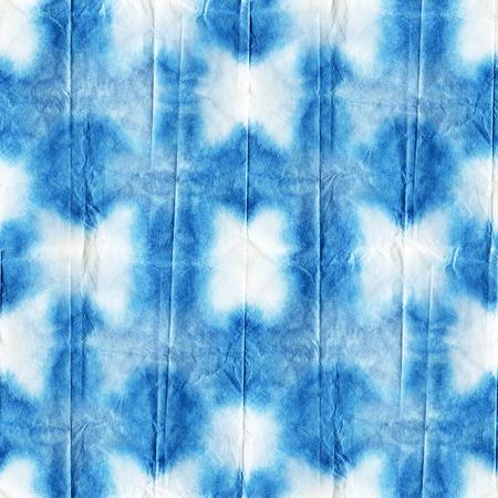 white silk: Seamless tie-dye pattern of indigo color on white silk. Hand painting fabrics - nodular batik. Shibori dyeing.
