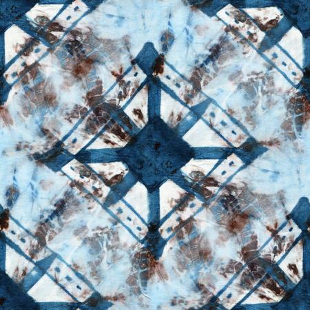 Seamless tie-dye pattern of indigo and brown color on white silk. Hand painting fabrics - nodular batik. Shibori dyeing.