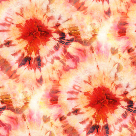 Seamless tie-dye pattern of orange color on white silk. Hand painting fabrics - nodular batik. Shibori dyeing.