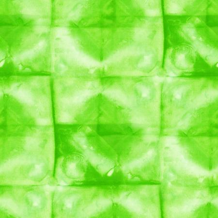 Seamless tie-dye pattern of green color on white silk. Hand painting fabrics - nodular batik. Shibori dyeing. Stock Photo