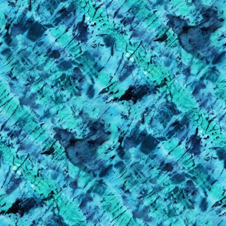 Seamless tie-dye pattern of indigo and green  color on white silk. Hand painting fabrics - nodular batik. Shibori dyeing.