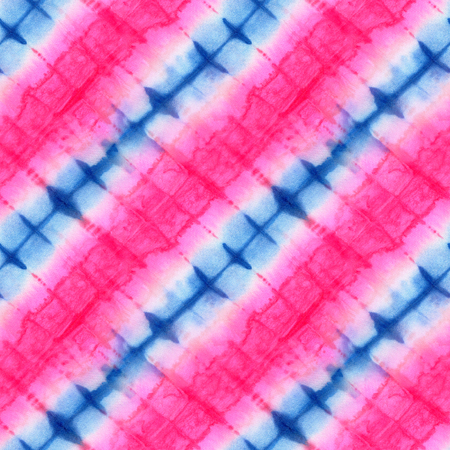 Seamless tie-dye pattern of pink and blue  color on white silk. Hand painting fabrics - nodular batik. Shibori dyeing.