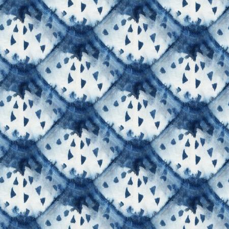 Seamless tie-dye pattern of indigo color on white silk. Hand painting fabrics - nodular batik. Shibori dyeing.