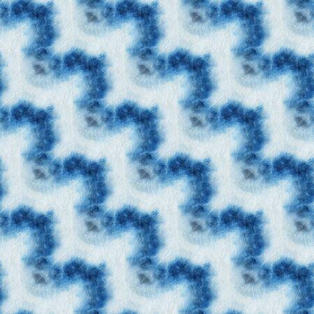 Seamless tie-dye pattern of indigo color on white silk. Hand painting fabrics - nodular batik. Shibori dyeing. Imagens