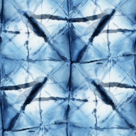 Seamless tie-dye pattern of indigo color on white silk. Hand painting fabrics - nodular batik. Shibori dyeing.  Reklamní fotografie