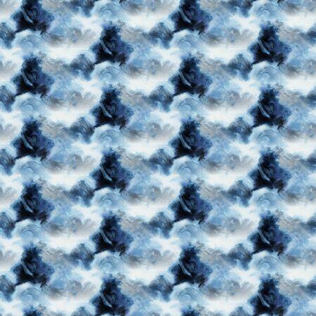 Seamless tie-dye pattern of indigo color on white silk. Hand painting fabrics - nodular batik. Shibori dyeing.  Stock Photo