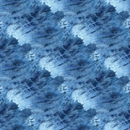 Seamless tie-dye pattern of indigo color on white silk. Hand painting fabrics - nodular batik. Shibori dyeing.  Фото со стока