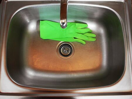 sink with green gloves