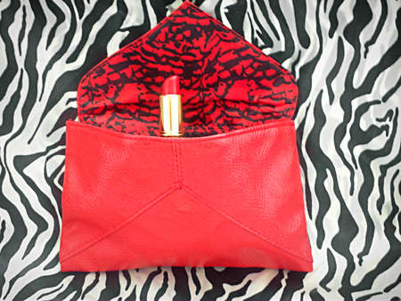 Red lipstick in red bag