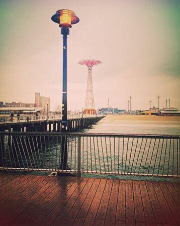 coney: Rainy day on Coney Island boardwalk Editorial