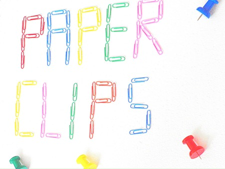 colorful paper clips on white background